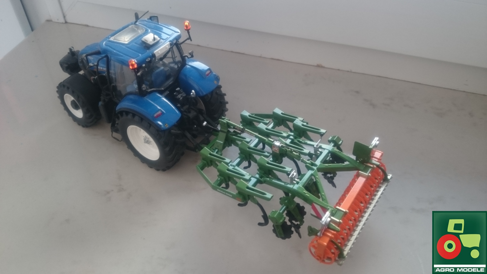 New Holland T7.210 + Amazone Cenius 3002